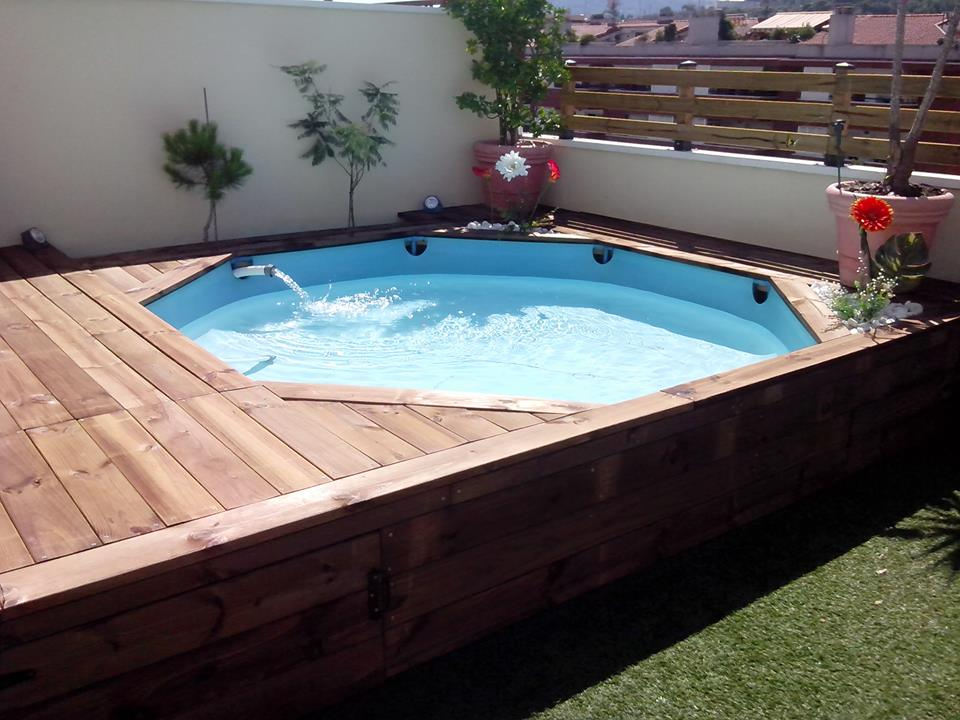 tarima de madera en una piscina de pl stico leroy merlin. Black Bedroom Furniture Sets. Home Design Ideas